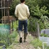 man-walking-community-garden