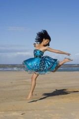 young-woman-dancing-beach